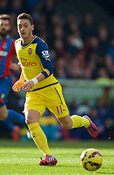 LONDON, ENGLAND - Saturday, February 21, 2015: Arsenal's Mesut Ozil in action against Crystal Palace during the Premier League match at Selhurst Park. (Pic by David Rawcliffe/Propaganda)