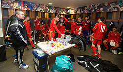 NEWPORT, WALES - Thursday, November 5, 2015: Wales' head coach Osian Roberts speaks to the players in the dressing room after the 3-1 victory over Northern Ireland during the Under-16's Victory Shield International match at Dragon Park. (Pic by David Rawcliffe/Propaganda)