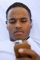 Man Holding MP3 Player