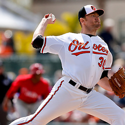 Mar 3, 2013; Sarasota, FL, USA; Baltimore Orioles starting pitcher Chris Tillman (30) throws against the Philadelphia Phillies during the top of the first inning of a spring training game at Ed Smith Stadium. Mandatory Credit: Derick E. Hingle-USA TODAY Sports