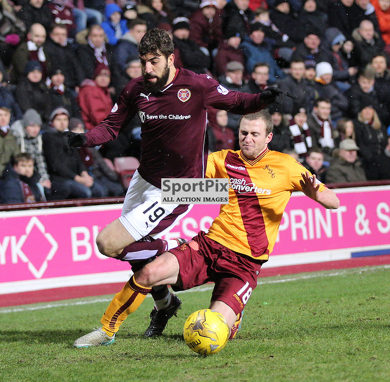 Hearts v Motherwell Scottish Premiership 16 January 2016; Josh Law (Motherwell, 18) puts in a heavy tackle on Juanma Delgado Lloria (Hearts, 19) during the Heart of Midlothian v Motherwell Scottish Premiership match played at Tynecastle Stadium, Edinburgh; <br /> <br /> &copy; Chris McCluskie | SportPix.org.uk