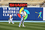 LOS ANGELES, CA - MARCH 23: Players from Korea warm up before playing against Japan in the final game of the 2009 World Baseball Classic at Dodger Stadium in Los Angeles, California on Monday March 23, 2009. Japan defeated Korea 5-3 in ten innings. (Photo by Paul Spinelli/WBCI/MLB Photos)