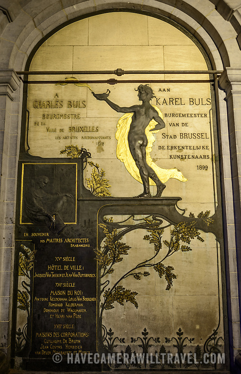 Memorial to former Brussels mayor Carel Buls in the Grand Place, Brussels. Originally the city's central market place, the Grand-Place is now a UNESCO World Heritage site. Ornate buildings line the square, including guildhalls, the Brussels Town Hall, and the Breadhouse, and seven cobbelstone streets feed into it.