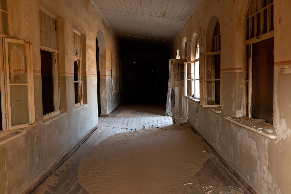 A corridor of a public building in the abandoned old mining town of Kolmanskop, Namibia