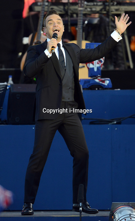 Robbie Williams   at the Diamond Jubilee Concert  held at Buckingham Palace, London on Monday, 4th  June 2012. Photo by: i-Images