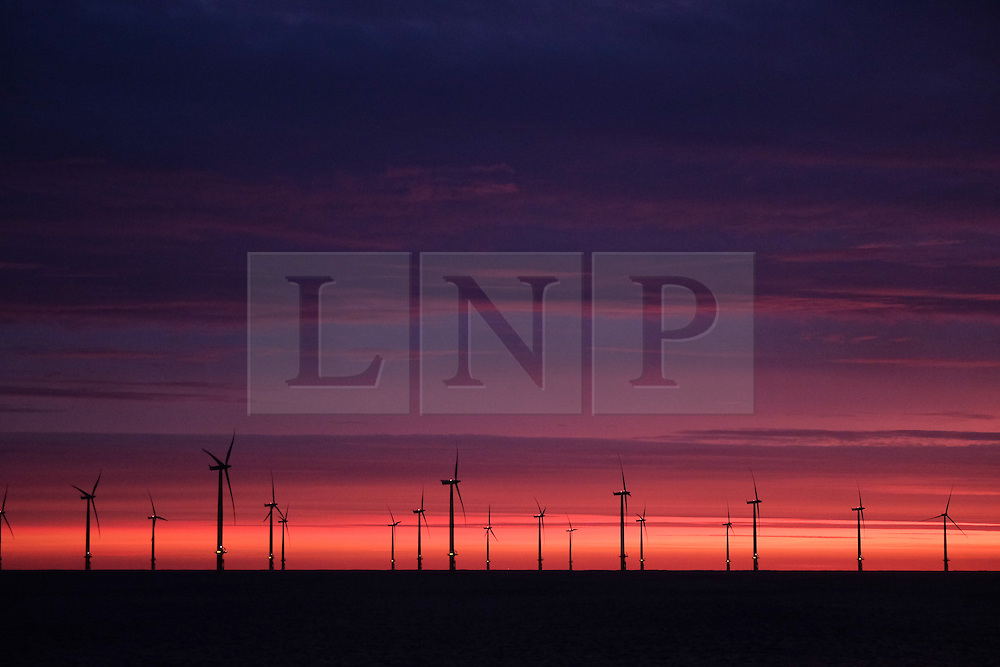 © Licensed to London News Pictures. <br /> 09/12/2014. <br /> <br /> Teesside, United Kingdom<br /> <br /> A beautiful sunrise starts the day over the offshore wind farm at Redcar on Teesside as strong winds are expected to pick up through the day as the winter weather continues.<br /> <br /> <br /> Photo credit : Ian Forsyth/LNP