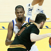 04 June 2017: Golden State Warriors forward Kevin Durant (35) defends on Cleveland Cavaliers forward Kevin Love (0) during the Golden State Warriors 132-113 victory over the Cleveland Cavaliers, in game 2 of the 2017 NBA Finals, at the Oracle Arena, Oakland, California, USA.