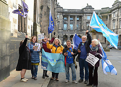 Pictured: Supporters celebrate outside the Court after the ruling.<br /> <br /> A cross-party group of over 70 politicians today won their appeal before the Court of Session seeking to rule that the UK government and Prime Minister Boris Johnson acted unlawfully in proroguing parliament.<br /> <br /> © Dave Johnston / EEm