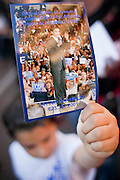 19 JANUARY 2009 -- PHOENIX, AZ: A boy carries a card honoring Barack Obama during a march to honor slain civil rights leader Dr. Martin Luther King Jr in Phoenix. About 500 people marched three miles through Phoenix, Monday Jan. 19, in memory of Dr. Martin Luther King Jr. This year the march also marked Jan 20 inauguration of Barack Obama as the US President.     PHOTO BY JACK KURTZ