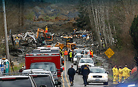 Workers search the debris that flowed across Highway 530 in the mudslide near Oso, Washington as efforts continued to find victims March 26, 2014. The death toll from a massive landslide in Washington state stood at 24 on Wednesday, but the mud-stricken community braced for a higher body count as search teams combed through debris looking for scores of people still missing four days after the disaster. REUTERS/Rick Wilking(UNITED STATES)
