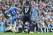 Everton striker Wayne Rooney (10) tackles Brighton and Hove Albion midfielder Pascal Gross (13) during the Premier League match between Brighton and Hove Albion and Everton at the American Express Community Stadium, Brighton and Hove, England on 15 October 2017. Photo by Phil Duncan.
