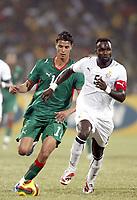 Fotball<br /> Afrika mesterskapet 2008<br /> Foto: DPPI/Digitalsport<br /> NORWAY ONLY<br /> <br /> FOOTBALL - AFRICAN CUP OF NATIONS 2008 - QUALIFYING ROUND - GROUP A - 28/01/2008 - GHANA v MOROCCO - JOHN MENSAH (GHA) / MAROUANE CHAMAKH (MOR)<br /> <br /> Ghana v Marokko