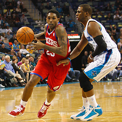January 3, 2011; New Orleans, LA, USA; Philadelphia 76ers point guard Lou Williams (23) drives past New Orleans Hornets point guard Chris Paul (3) during the first quarter at the New Orleans Arena.   Mandatory Credit: Derick E. Hingle