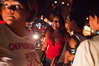 Residents walk in the streets during Carnaval in Rocinha, the biggest favela in Brazil, with over 100,000 residents, in Rio de Janeiro, Br., on Thursday, Jan. 24, 2013. In early November 2011 about 3,000 police officers and soldiers moved into one of the largest slums in Latin America in an effort by the Brazilian government to assert control over lawless areas of the city ahead of the 2014 World Cup and 2016 Summer Olympics.