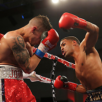 KISSIMMEE, FL - MARCH 06:  Jeffrey Ramos (R) catches Jovan Perez with an overhand left during the Telemundo Boxeo boxing match at the Kissimmee Civic Center on March 6, 2015 in Kissimmee, Florida. Ramos won the bout by split decision. (Photo by Alex Menendez/Getty Images) *** Local Caption *** Felix Verdejo; Sergio Villanueva