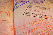 Passport page with Roissy-CDG  French immigration control stamp.