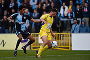 Accrington defender Matty Pearson holds off Wycombe defender Sido Jombati during the Sky Bet League 2 match between Wycombe Wanderers and Accrington Stanley at Adams Park, High Wycombe, England on 30 April 2016. Photo by David Charbit.