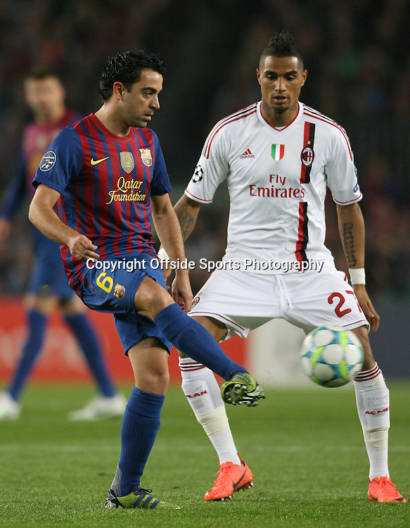 03/04/2012 - UEFA Champions League - Quarter Final (2nd Leg) - FC Barcelona vs. AC Milan - Xavi of Barcelona battles with Kevin-Prince Boateng of Milan - Photo: Simon Stacpoole / Offside.