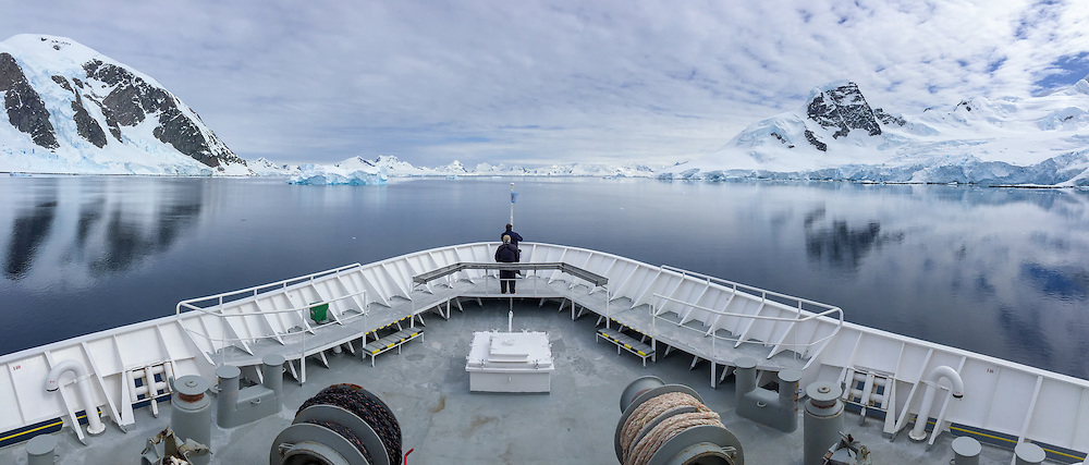 Ship bow POV passing by ice at Danko Island on the Antarctic Peninsula.