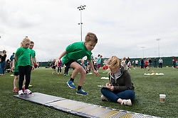 A young boy attempts a long jump during the Bristol Sport festival - Photo mandatory by-line: Dougie Allward/JMP - Mobile: 07966 386802 - 06/06/2015 - SPORT - Multi-Sport - Bristol - SGS Wise Campus - Bristol Sport Festival Of Youth Sport - Festival Of Youth