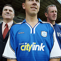 St Johnstone launch new strip and new sponsor 04.07.02<br />New signing John Robertson models the new home strip alongside Neil Wood, Managing Director of Citylink the clubs new sponsor and Manager Billy Stark<br />.<br />see story by Gordon Bannerman Tel: 01738 493213 or contact Charles Mann on 0131 558 3111<br /><br />Picture by Graeme Hart.<br />Copyright Perthshire Picture Agency<br />Tel: 01738 623350  Mobile: 07990 594431