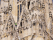 "Vienna, Austria. The ""Walk am Dom"" is the highlight of St. Stephen's fair (Steffl-Kirtag) at the beginning of the ""Long Night of Churches"" (Lange Nacht der Kirchen..Slackliner Christian Waldner crosses between St. Stephen's South Tower ""Steffl"" to the Heidenturm and back - on a one inch wide slack line in a height of 60 meters.."