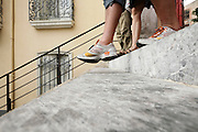 low angle view of people walking down the stairs