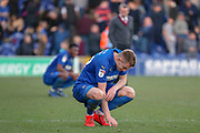 AFC Wimbledon striker Joe Pigott (39) looking down at floor after final whistle during the EFL Sky Bet League 1 match between AFC Wimbledon and Charlton Athletic at the Cherry Red Records Stadium, Kingston, England on 23 February 2019.