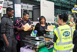 London, UK. 17 June, 2019. Outsourced catering, security, postal, porter and cleaning staff belonging to the Public & Commercial Services Union (PCS) and working at the Department for Business, Energy and Industrial Strategy (BEIS) via contractors ISS World and Aramark attend a 'Jamaican cookout' on the picket line outside the Government department on the first day of continuing industrial action for the London Living Wage, terms and conditions comparable to the civil servants they work alongside and an end to outsourcing. Credit: Mark Kerrison/Alamy Live News
