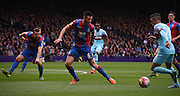 Scott Dann watches closely as Dimitri Payet goes on the attack during the Barclays Premier League match between Crystal Palace and West Ham United at Selhurst Park, London, England on 17 October 2015. Photo by Michael Hulf.