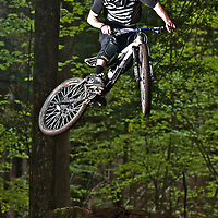 Sean Guy tail whips off a jump on East Rock Great Barrington, Massachusetts
