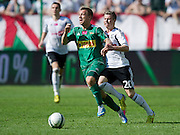 (R) Legia's Jakub Kosecki fights for the ball with (L) Lechia's Pawel Buzala during T-Mobile Extraleague soccer match between Legia Warsaw and Lechia Gdansk at Pepsi Arena in Warsaw, Poland...Poland, Warsaw, May 05, 2013..Picture also available in RAW (NEF) or TIFF format on special request...For editorial use only. Any commercial or promotional use requires permission...Photo by © Adam Nurkiewicz / Mediasport