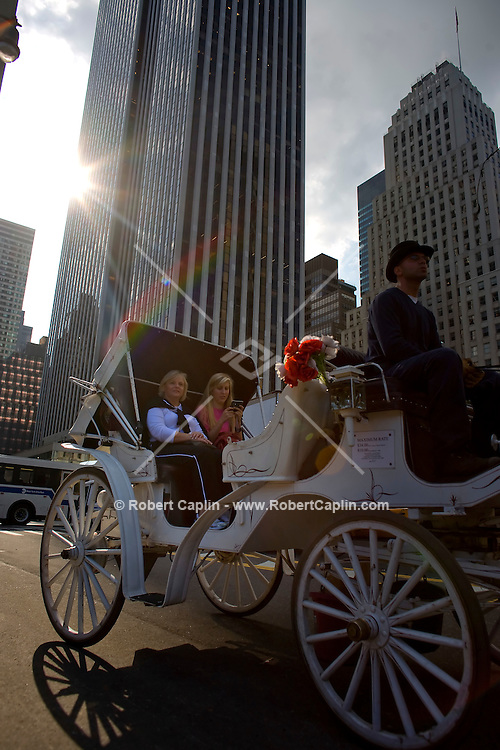 Tourists are taken by horse drawn carriage to Central Park via 59th Street in New York. Sept. 30, 2008. Robert Caplin For The New York Times