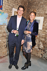 LEO MILLS and DAISY FELLOWES at a private view of various works of art at the Art Cellar, 41a Farringdon Street, London on 4th October 2012.