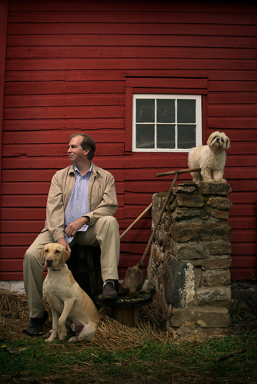 Bill Smith is the founder of the Main Line Animal Rescue in Wayne, Pa. He is pictured with two dogs who are current residents at the group's Wayne facility.
