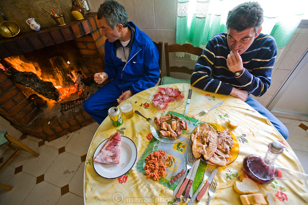 Sheepherder Miguel Angel Martinez Cerrada and his brother Paco eat at their home in Zarzuela de Jadraque, Spain. (Miguel Angel Martinez Cerrada  is featured in the book What I Eat: Around the World in 80 Diets.)  Because the brothers eat mainly meat, they're largely self-sufficient when it comes to food. Because there isn't a bakery or market in their small village, they shop once a week in Guadalajara or another larger town about a half-hour drive away.  MODEL RELEASED.