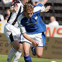 St Mirren v St Johnstone...21.08.04<br />Ryan Stevenson pulls away from Mark Reilly<br /><br />Picture by Graeme Hart.<br />Copyright Perthshire Picture Agency<br />Tel: 01738 623350  Mobile: 07990 594431