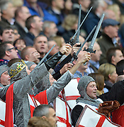 Twickenham, GREAT BRITAIN,  England supporters, dressed as Lionheart Crusaders, swords raised, during the National Anthem.  QBE. International Series, England vs Fiji, Autumn International at Twickenham Stadium, Surrey on   Saturday  10/11/2012.  Mandatory Credit  [Peter Spurrier/Intersport-images]
