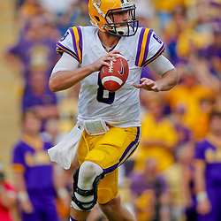 Oct 12, 2013; Baton Rouge, LA, USA; LSU Tigers quarterback Zach Mettenberger (8) against the Florida Gators during the second half of a game at Tiger Stadium. LSU defeated Florida 17-6. Mandatory Credit: Derick E. Hingle-USA TODAY Sports