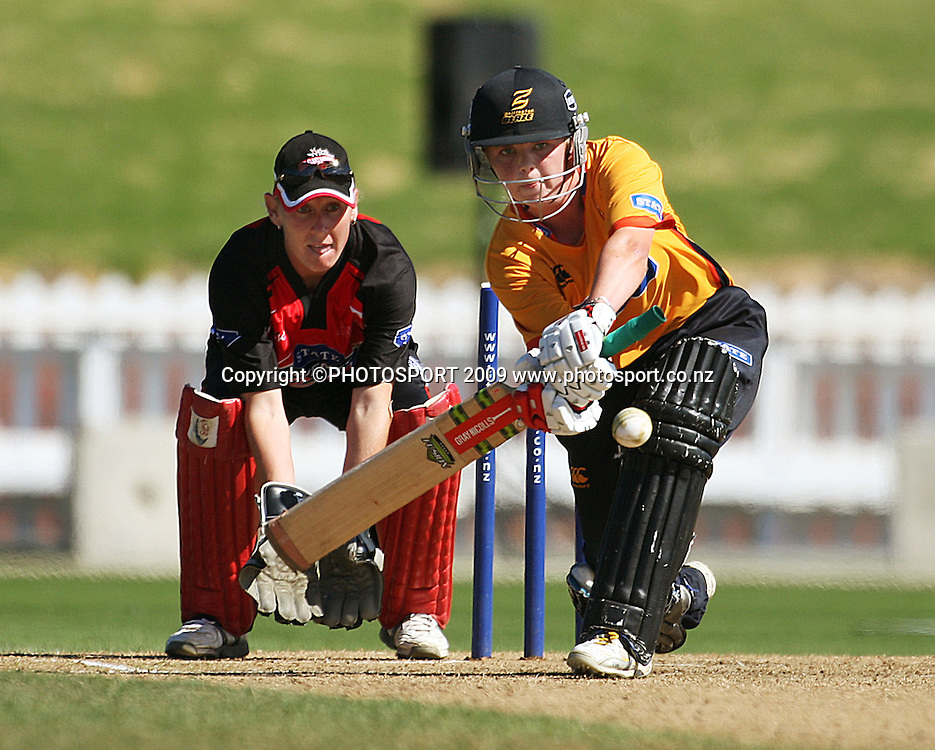 Wellington's Lucy Doolan bats as keeper Rowan Milburn waits.<br /> State League 20/20 final. Wellington Blaze v Canterbury Magicians at Allied Prime Basin Reserve, Wellington. Saturday, 25 January 2009. Photo: Dave Lintott/PHOTOSPORT