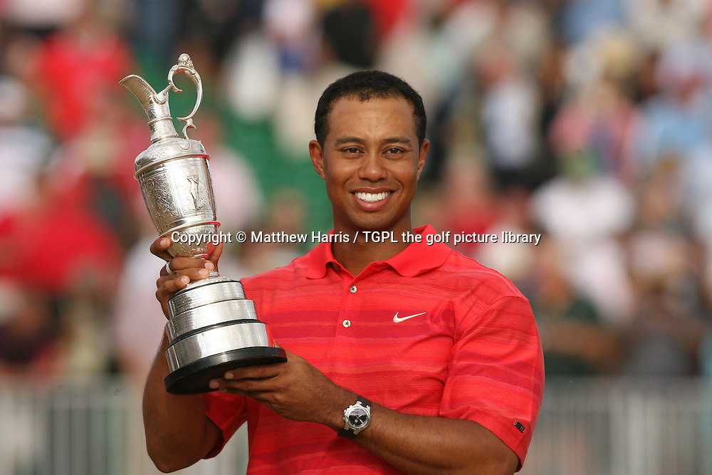 Tiger WOODS (USA) hold's the famous claret jug trophy for the 3rd time during fourth round The Open Championship 2006,Royal Liverpool,Hoylake,Wirral,England.