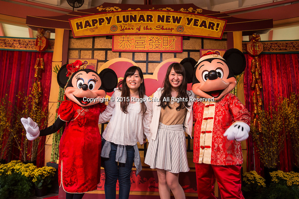 Mickey Mouse and Minnie Mouse pose with guests at the Paradise Garden in Disney California Adventure Park during the Happy Lunar New Year Celebration on Saturday February 21, 2015 in Anaheim, California. (Photo by Ringo Chiu/PHOTOFORMULA.com)