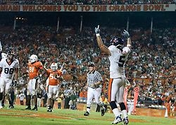 Virginia running back Mikell Simpson (5) celebrates after scoring a touchdown.  The #19 Virginia Cavaliers defeated the Miami Hurricanes 48-0 at the Orange Bowl in Miami, Florida on November 10, 2007.  The game was the final game played in the Orange Bowl.