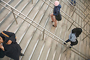 people walking up and down the stairs