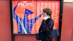 People queue outside the Royal Albert hall for the first night of the proms, London, United Kingdom, July 14, 2000. Photo by Andrew Parsons / i-Images.