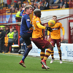 Kyle Lafferty (Hearts) and Cedric Kipre (Motherwell) during the Scottish Cup quarter final between Motherwell and Hearts at Fir Park, where the home side made it into the semi final draw with a win.<br /> <br /> (c) Dave Johnston | sportPix.org.uk