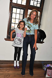 TRINNY WOODALL and her daughter LAYLA ELICHAOFF at a Hello Kitty Event at Liberty to lauch their collection of Hello Kitty products at Liberty, Great Marlborough Street, London on 25th September 2011.