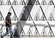 Feb. 24, 2016 - Los Angeles, California, U.S - <br /> <br /> A worker walks by the backdrop for the arrivals area for the Oscars in front of the Dolby Theatre in Los Angeles, Wednesday. The 88th Academy Awards will be held Sunday, February 28, 2016. <br /> ©Exclusivepix Media