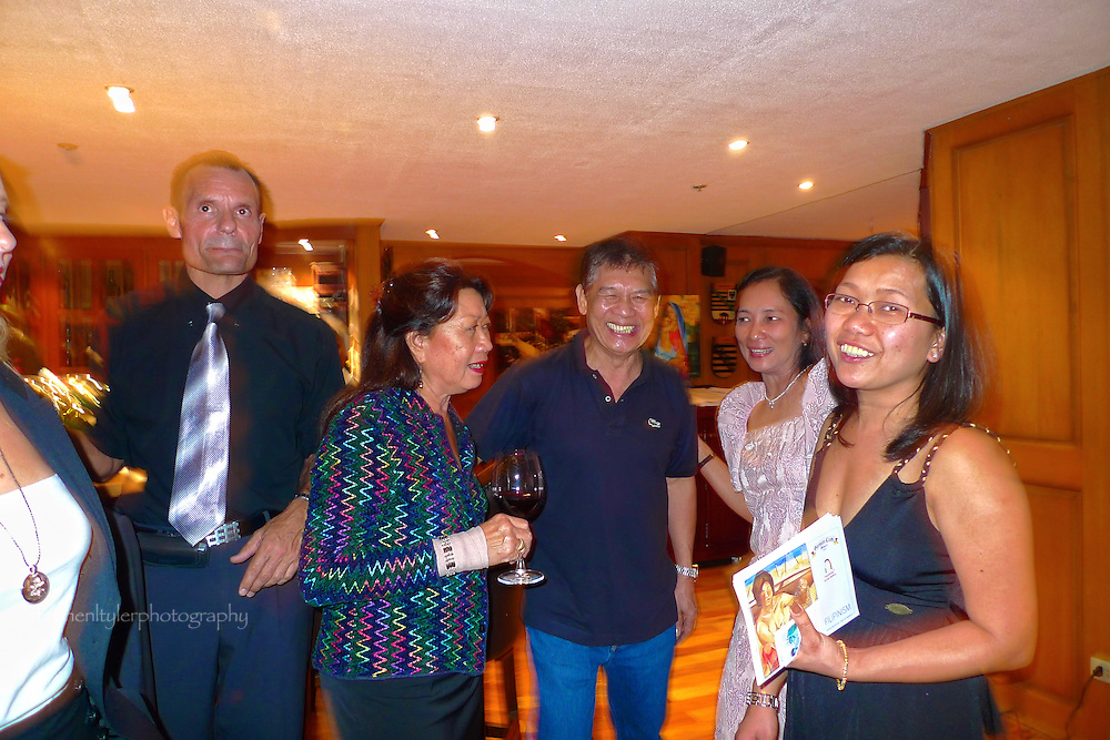 "Ms. Rica Cortes Rentzing with Ronna Manansala (grand daughter of National Artist Vicente Manansala) and Master Water Colorist Rafael ""Popoy"" Cusi during opening night exhibition of Filipinism at the German Club in Manila with Transwing Kunst Gallery owners and patrons, Jane and Klaus Hartung."