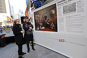 "Award-winning photojournalist Peter Menzel, right, and writer Faith D'Aluisio view their ground-breaking photo series, ""Waste in Focus,"" sponsored by The Glad Products Company, Thursday, April 10, 2014 in New York. The photo series reveals the amount of trash U.S. families produce in an average week. Visit wasteinfocus.com to learn more about the photo exhibit.  (Photo by Diane Bondareff/Invision for The Glad Products Company/AP Images)"